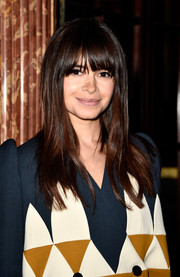 Miroslava Duma looked oh-so-pretty at the Balmain fashion show with her long hair and eye-skimming bangs.