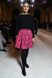 Olivia Palermo livened up her dark top with a printed fuchsia mini skirt by Balmain.