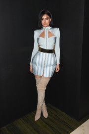 Kylie Jenner paired her top with a striped blue mini skirt, also by Balmain.