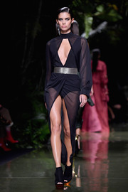 Sara Sampaio flaunted her legs and cleavage in a sheer black cutout dress while walking the Balmain runway.
