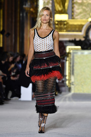 A midi pencil skirt that featured a flurry of feathers and studs finished off Natasha Poly's look.