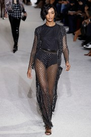 Jourdan Dunn totally slayed in this fishnet pantsuit at the Balmain runway show.