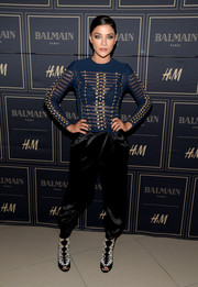 Jessica Szohr completed her punchy attire with a pair of geometric-beaded open-toe ankle boots, also by Balmain x H&M.