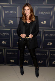 Cindy Crawford was glam-drogynous in an oversized black blazer with gold buttons at the Balmain x H&M Los Angeles pre-launch.