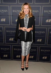Cat Deeley looked flawlessly put together in a tailored black cape layered over a snakeskin-print dress at the Balmain x H&M Los Angeles pre-launch.