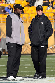 Coach Mike Tomlin stays warm in a gray vest.