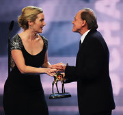 Kate wore a messy, textured bun with a shoulder-beaded black gown. This soft look is very feminine and sweet.