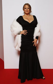 Barbara Schoeneberger channeled '50s elegance in a long velvet gown with a white fur shawl.