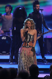 Shakira wears a leopard print bodysuit under her skirt for performing at the Bambi Awards.