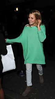 Caggie Dunlop stepped out at a party wearing a comfy boatneck sweater paired with skinny jeans.