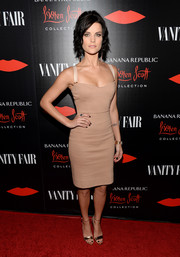 Jaimie Alexander paired her dress with gold evening sandals for a chicer finish.
