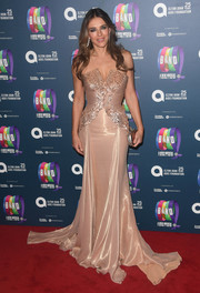 Elizabeth Hurley looked picture-perfect in a strapless blush gown by Versace at the charity gala performance of 'The Band.'
