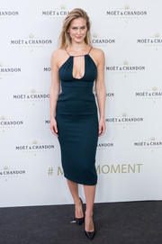 Bar Refaeli put on a busty display in a low-cut teal midi dress during the Moet & Chandon New Year's Eve party.