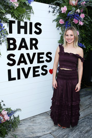 Kristen Bell looked summer-ready in a smocked purple crop-top by Rebecca Taylor at the press launch of This Bar Saves Lives.