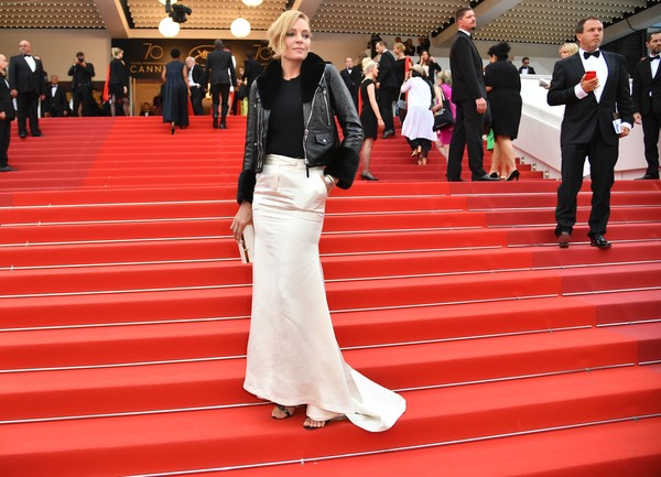 Uma Thurman teamed an ivory satin fishtail skirt with a black leather jacket for the Cannes Film Festival screening of 'Barbara.'