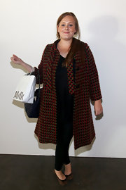 Adele wore a pair of leopard print ballet flats with her black ensemble and tweed coat for the Barbara Tfank presentation.