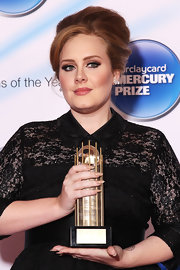 Adele wore her strawberry locks in her signature bouffant for the Barclaycard Mercury Prize.