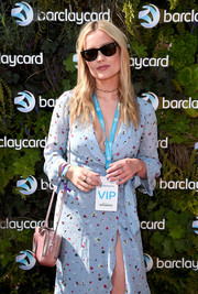 Laura Whitmore stayed classic with a pair of Ray-Ban wayfarers at the British Summer Time Hyde Park.