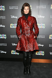Linda Evangelista donned a hot red animal print coat at the Barneys New York event.