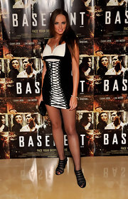 Victoria showed off her corset dress and cut out ankle boots while attending the 'Basement' premiere.
