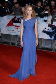 Holly Hunter chose a fluttery periwinkle gown with an asymmetrical neckline and a layered hem for her 'Batman v Superman' European premiere look.