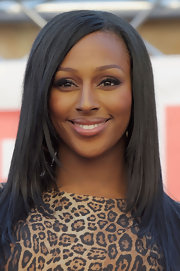 Alexandra Burke kept her makeup palette neutral at an event in London. After sweeping on some black liquid liner she used warm brown tones along her lids and blended up into the creases.