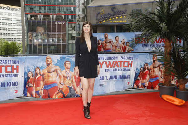 Alexandra Daddario put a sexy spin on menswear dressing with this plunging black tuxedo dress by Dsquared2 at the 'Baywatch' photocall in Berlin.