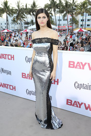 Alexandra Daddario cut a shapely silhouette in a figure-hugging Azzaro Couture off-the-shoulder gown, rendered in silver sequins with black lace panels, during the world premiere of 'Baywatch.'