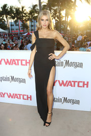 Charlotte McKinney showed off her figure in a high-slit black one-shoulder gown by Baja East at the world premiere of 'Baywatch.'