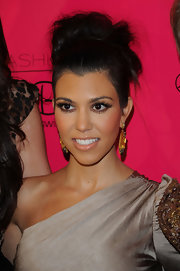 Kourtney showed off her loose high bun while hitting the red carpet at the Beach Bunny fashion show.