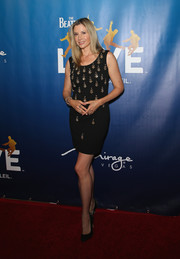 Mira Sorvino donned a mirror-embellished LBD for the 'Beatles LOVE by Cirque du Soleil' 10th anniversary.