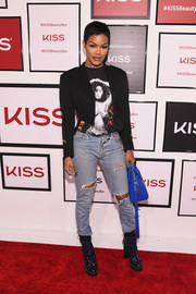 Teyana Taylor layered a cropped jacket over a Janet Jackson tee for the Beauty Bar by KISS event.