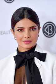 Priyanka Chopra kept it simple with this center-parted ponytail at Beautycon Los Angeles 2019.