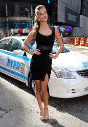 Nina Agdal paired her head-turning dress with basic nude platform peep-toes.