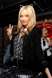 Me-ow! Laura Whitmore looked adorable in a cat-eared headband showing off her DJ skills in London.