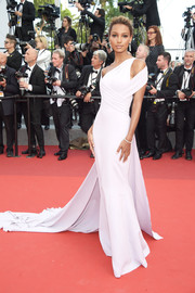 Jasmine Tookes exuded modern glamour in a pale-lilac Georges Chakra Couture gown with shoulder cutouts and a long train at the Cannes Film Festival screening of 'The Beguiled.'