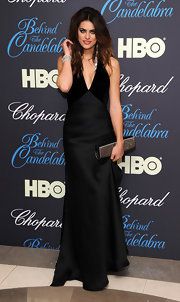 Alyson Le Borges looked lovely as ever in a plunging black satin gown.