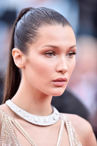 Bella Hadid Ponytail [hair,face,eyebrow,hairstyle,fashion,beauty,skin,chin,fashion model,lip,bella hadid,cannes,france,red carpet arrivals,cafe society,cafe society opening gala,cannes film festival,premiere,opening night gala,palais des festivals]