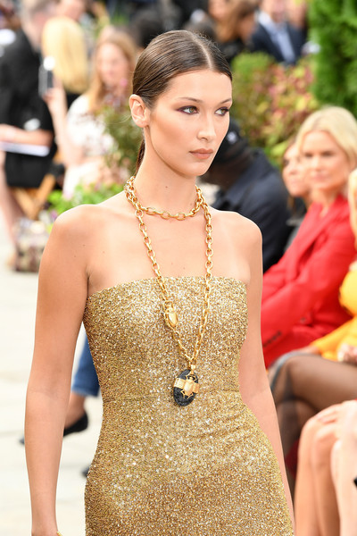 Bella Hadid Oversized Pendant Necklace [shows,the shows,hair,fashion model,fashion,clothing,shoulder,hairstyle,dress,beauty,lady,yellow,oscar de la renta,bella hadid,oscar de la renta - runway,runway,spring studios terrace,new york city,new york fashion week]