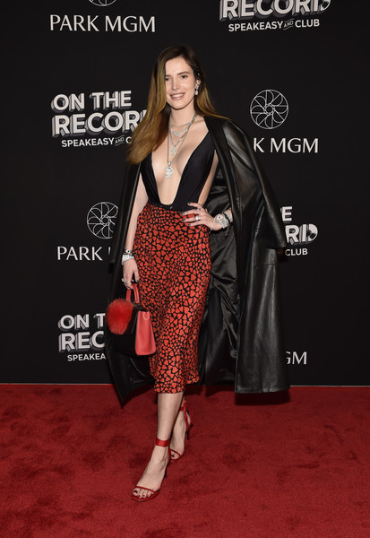 Bella Thorne Leather Coat [on the record,red carpet,clothing,carpet,dress,premiere,flooring,fashion,fashion model,footwear,event,bella thorne,speakeasy and club red carpet grand opening celebration at park mgm,las vegas,nevada,park mgm,opening,celebration,on the record speakeasy and club]