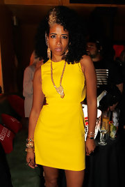 Kelis donned a bright yellow cutout dress to a pre-Grammy party.