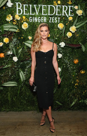 Nina Agdal flaunted her supermodel figure in a fitted LBD at the Belvedere Vodka Ginger Zest party.
