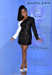 Janelle Monae looked playfully chic in a black Hellessy tux dress with a contrast off-the-shoulder sleeve at the launch of 'A Beautiful Future' limited edition bottle.