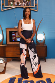Kelly Rowland teamed her chic pants with a simple white tank top.
