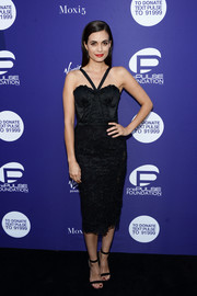 Torrey Devitto matched her frock with black ankle-strap sandals.