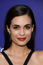 Torrey Devitto brightened up her pretty face with bold red lipstick.