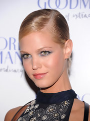 Erin Heatherton paired her severe updo with silvery shadow at the Bergdorf ferte.