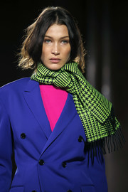 Bella Hadid looked winter-ready with her patterned neon-green scarf at the Berluti Menswear Fall 2020 show.
