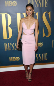 Jamie Chung stole the limelight in a pink Cushnie et Ochs dress, featuring a strappy, plunging neckline and cage detailing along the waist, at the New York screening of 'Bessie.'