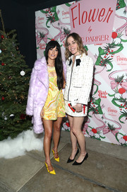Kacey Musgraves looked fancy in a lavender faux-fur coat by ASOS layered over a '60s-chic yellow dress at the Best Buds Holiday Party.